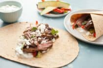Grilled Greek Steak Wraps: Marinated and grilled skirt steak with loads of grilled veggies and a quick tzatziki sauce. A hearty and delicious wrap! | macheesmo.com