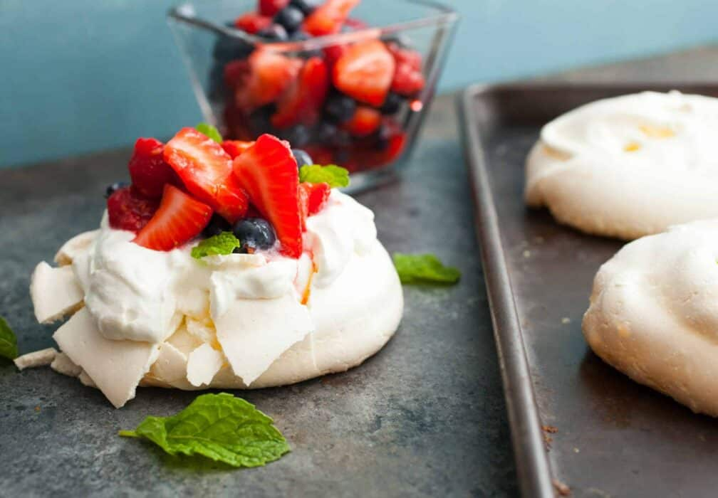 Triple Berry Mini Pavlovas: These might just be the perfect dessert for a hot summer day. Light and refreshing and just sweet enough. I like making them in mini form for easier serving also! | macheesmo.com