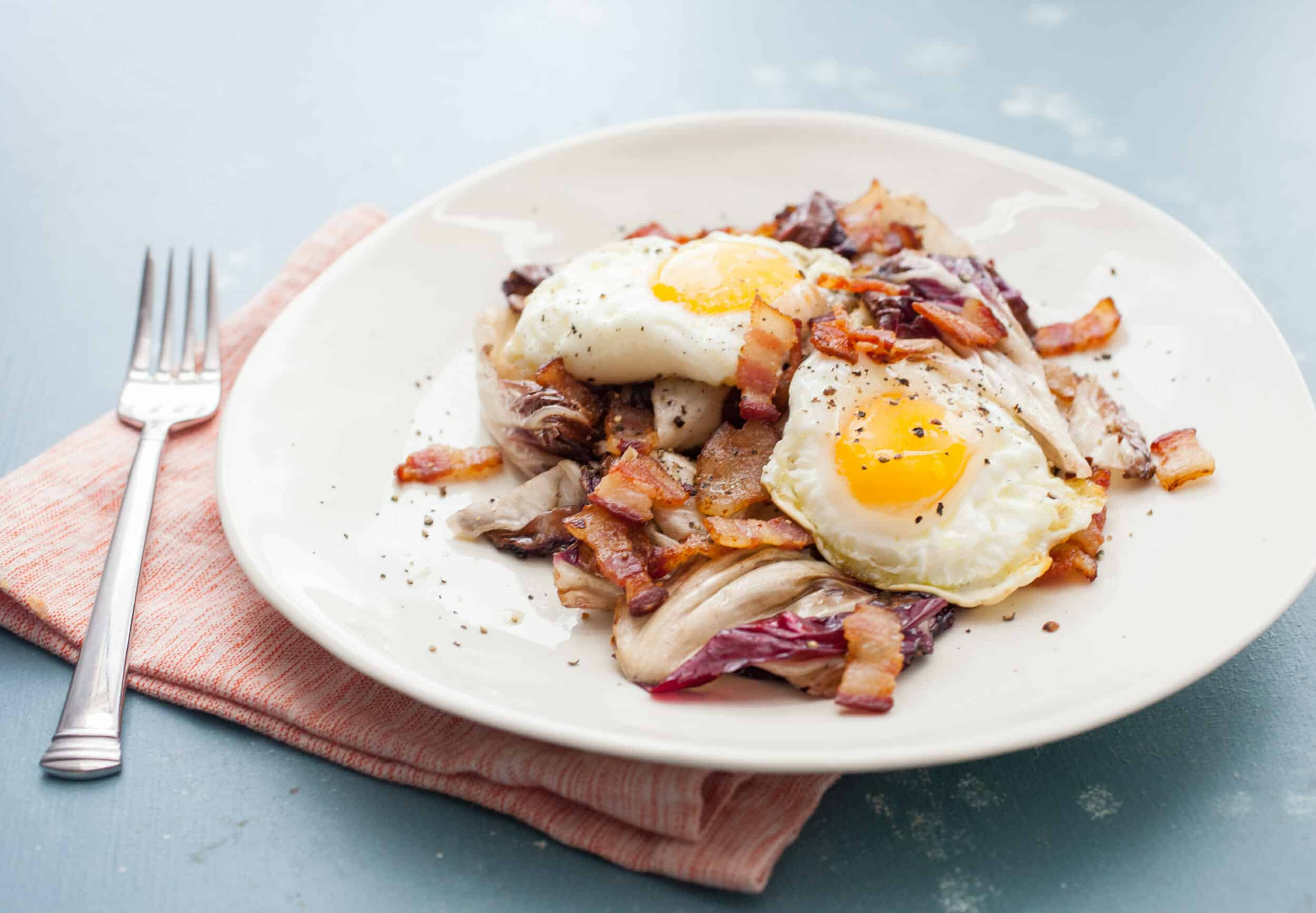 Grilled Radicchio Salad: This unassuming salad is jam-packed with flavor thanks to a bacon vinaigrette and some crispy eggs on top. YUM! | macheesmo.com