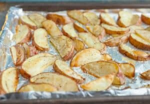 Salt and Vinegar Potato Wedges: The most addictive potato wedges out there. Easy to bake and even easier to eat. Roast them in the oven or toss them on a grill! | macheesmo.com