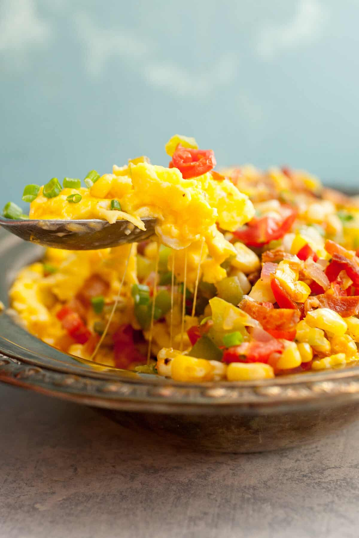 Loaded Scrambled Eggs: For the indecisive breakfast lover. This is too much filling to make an omelet with so I just piled it high and called it LOADED. A delicious breakfast, no doubt. | macheesmo.com