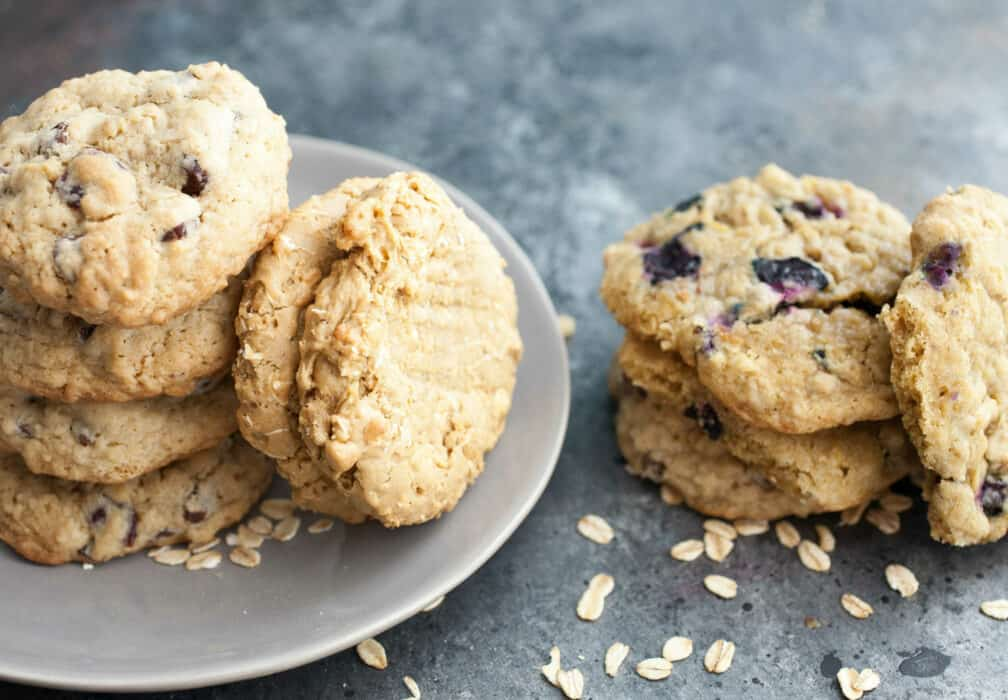 Oatmeal Cookies Three Ways: Basic oatmeal cookies with three new twists on them. If you're an oatmeal cookie fan, you'll want to try these! Versions include cherry chocolate, blueberry lemon, and peanut butter banana. | macheesmo.com
