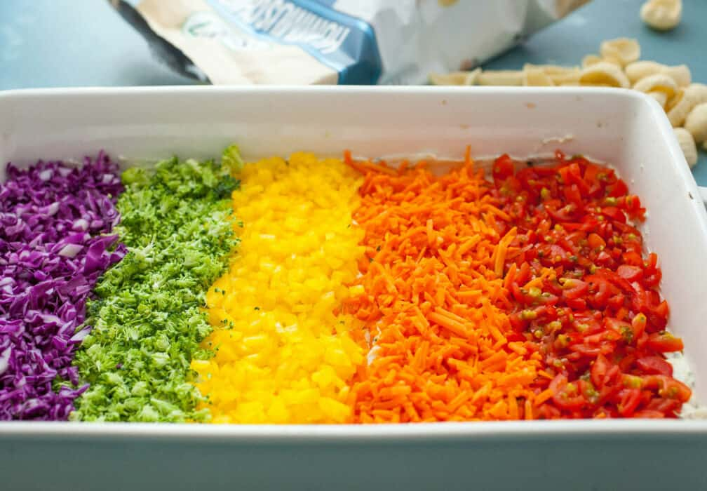 Rainbow Veggie Ranch Dip: This fun and colorful dip is easy to make, packed with healthy veggies, and so delicious! Perfect for a game day crowd! | macheesmo.com
