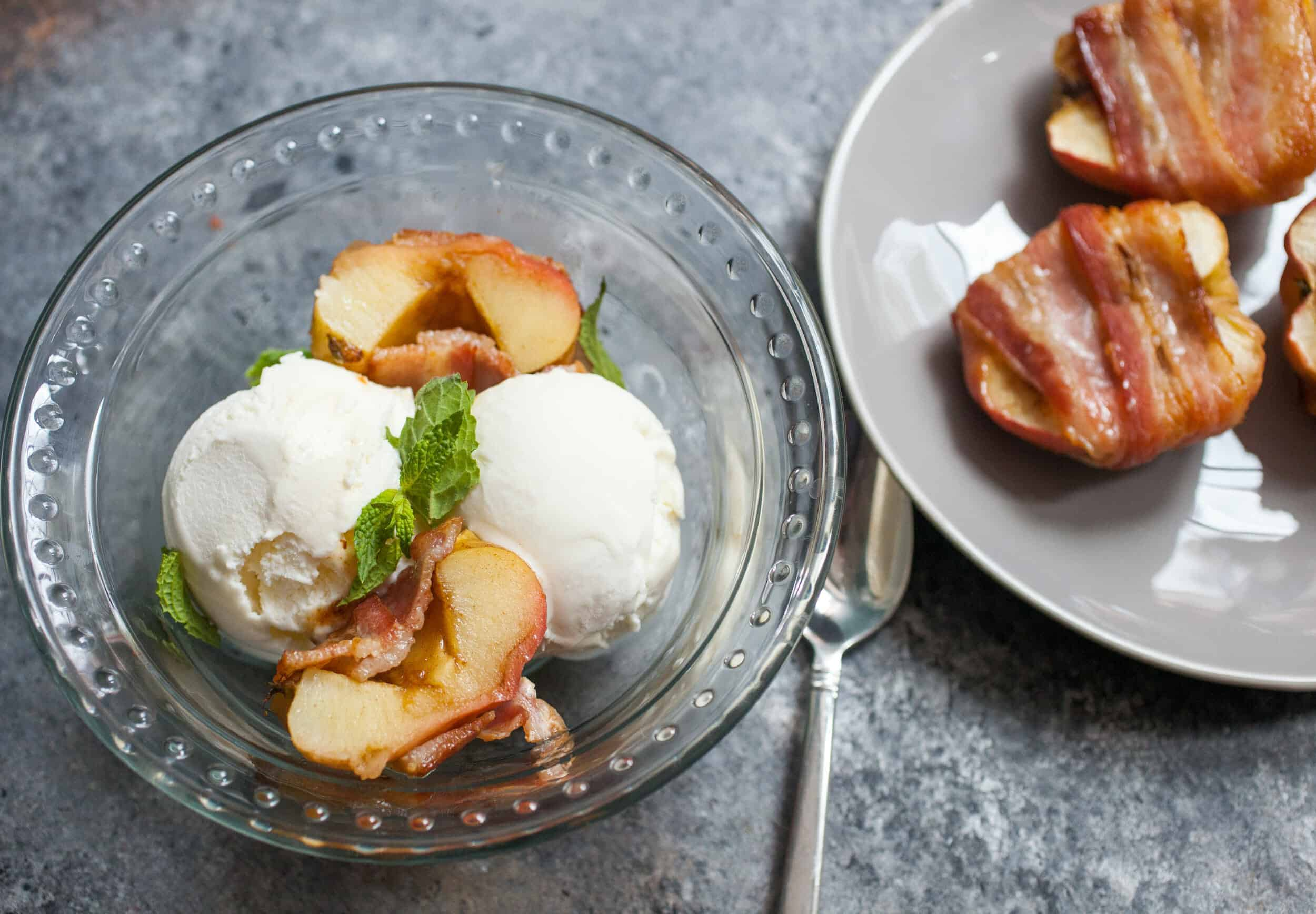 Bacon Wrapped Baked Apples: A slightly savory twist on dessert. Apples stuffed with brown sugar and spices and baked wrapped with bacon. HINT: Serve it with ice cream. YUP. | macheesmo.com