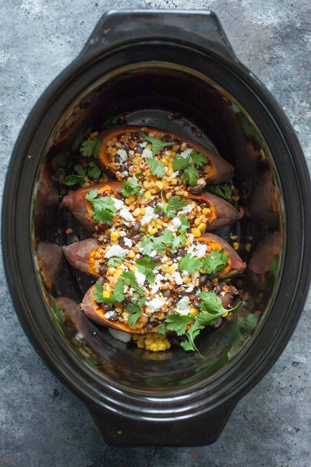 Stuffed Tex Mex Slow Cooker Sweet Potatoes: These sweet potatoes are the perfect mix of spicy, sweet, and savory and you can practically set them and forget them! A great vegetarian friendly meal! | macheesmo.com
