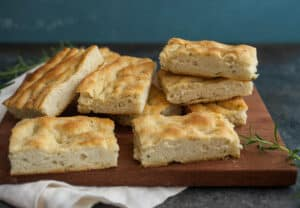 Thanksgiving Focaccia: If you're looking for a bread to change up your Thanksgiving recipe this year, this is a must try. Crispy and craggy and loads of flavor with a soft crumb, this focaccia has everything you want in a homemade bread. | macheesmo.com