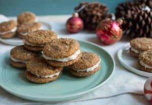 Gingerbread Sandwich Cookies: Soft gingerbread cookies coated in sparkling sugar and sandwiched around a simple buttercream filling. Your new favorite holiday cookie!   macheesmo.com