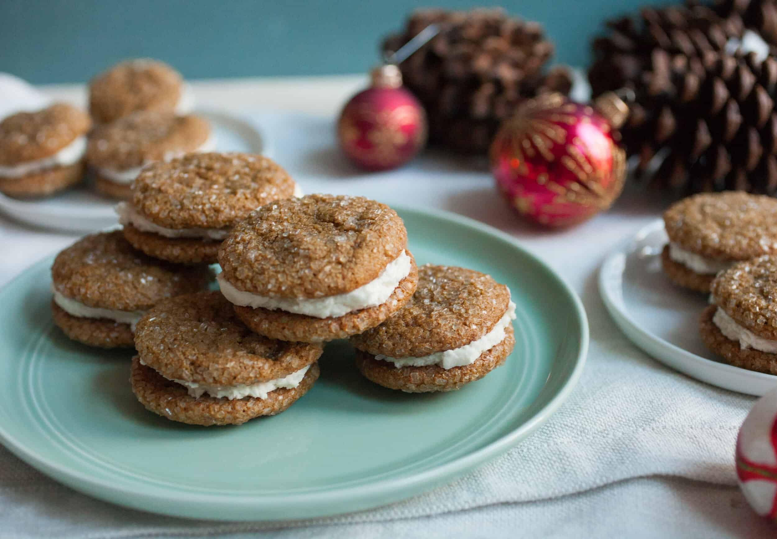 Gingerbread Sandwich Cookies: Soft gingerbread cookies coated in sparkling sugar and sandwiched around a simple buttercream filling. Your new favorite holiday cookie! | macheesmo.com