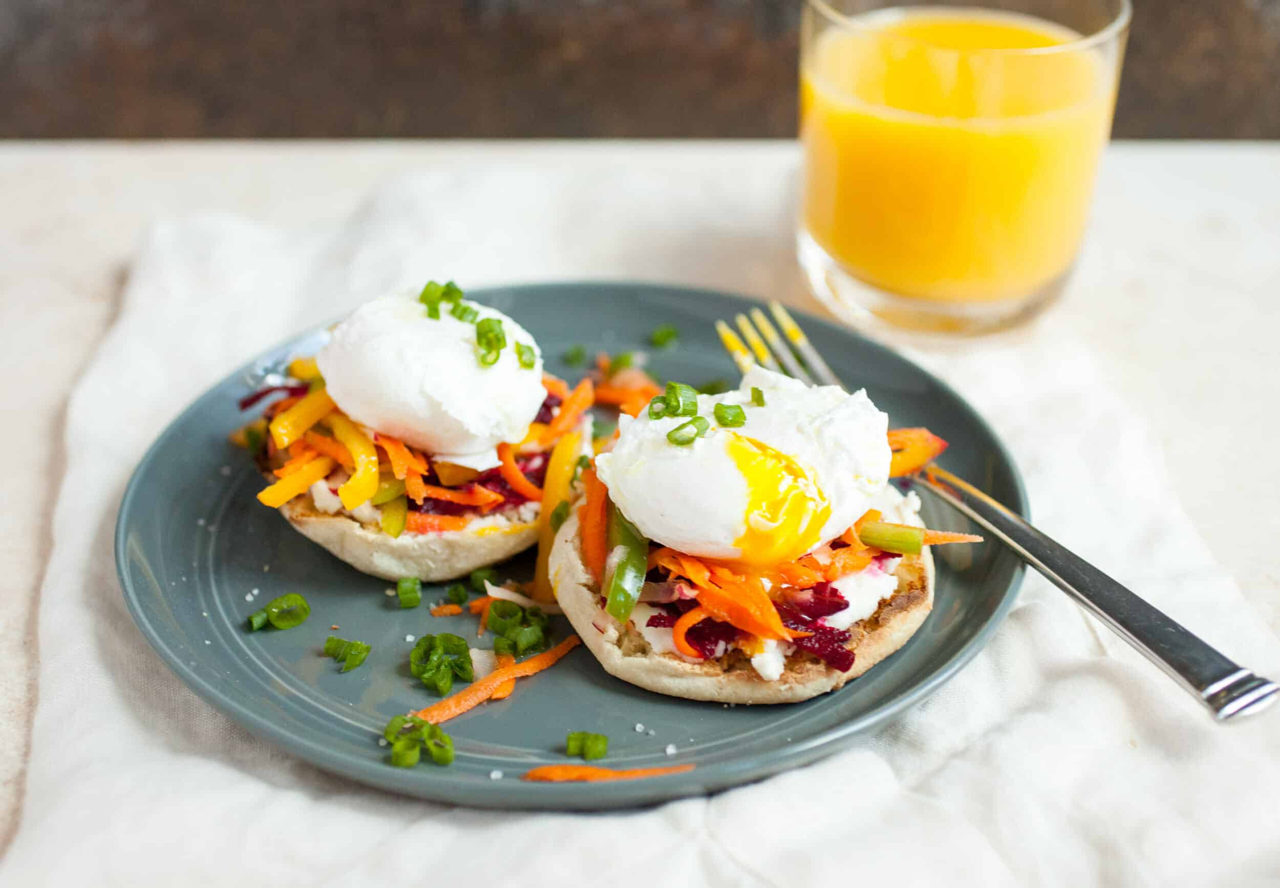 Ricotta Rainbow Veggie Toasts: These simple breakfast toasts are topped with loads of colorful veggies and perfect poached eggs for an easy and elegant way to start the day! | macheesmo.com