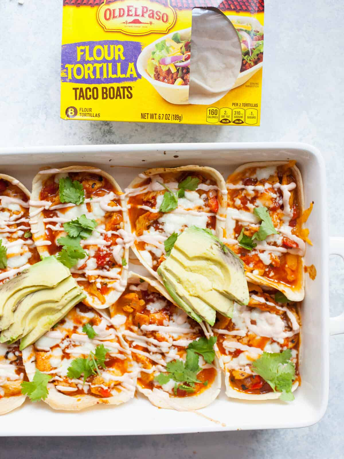 Pulled Chicken Enchilada Taco Boats: These easy baked taco boats have all the delicious flavors of a classic chicken enchilada dish but are about half the work! YUM! | macheesmo.com