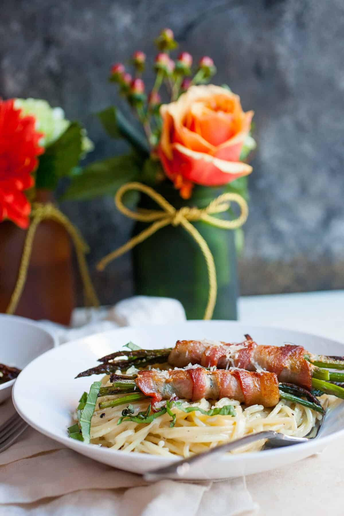 Asparagus Bundle Pasta: A simple cacio e pepe spaghetti topped with roasted bacon asparagus bundles. Yum! | macheesmo.com