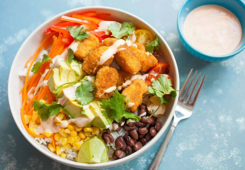 Buffalo Bites Bowls: These simple-to-make bowls are topped with Buffalo Fish Bites, loads of Tex-Mex veggies, and a simple spicy ranch sauce. Hard to beat! | macheesmo.com
