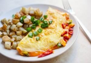 Pimento Cheese Omelet: An easy homemade pimento cheese spread folded inside a classic omelet. Your new favorite weekend omelet!   macheesmo.com