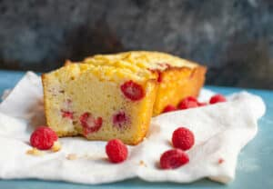 Ricotta Raspberry Pound Cake: A casual pound cake that's jam-packed with fresh raspberries. Using ricotta makes it dense, rich, and slightly tangy. It's the kind of simple quick bread that's dangerous to have around, but don't worry. It won't last long! | macheesmo.com