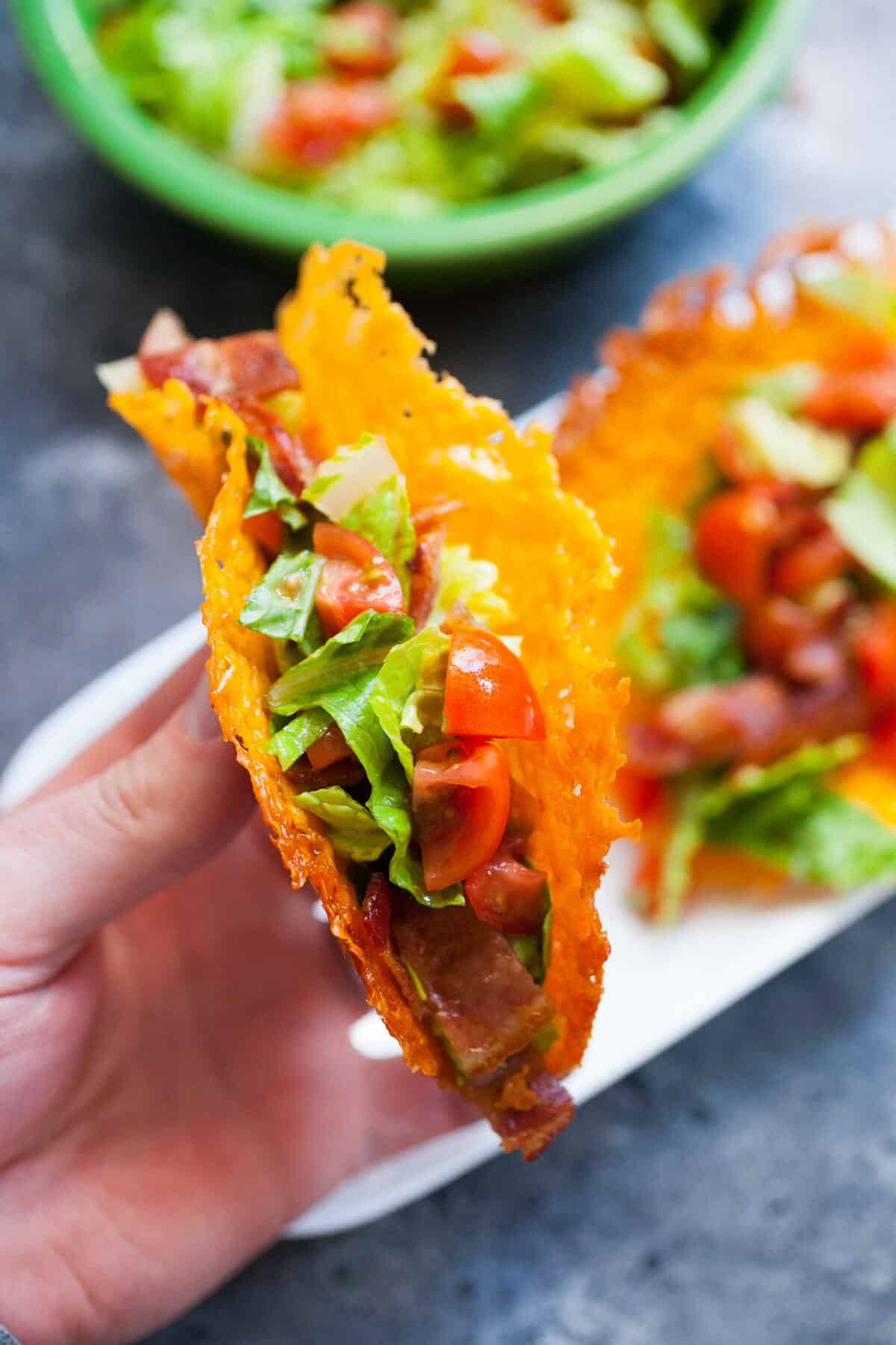 How to Make Cheese Taco Shells: These are a fun change up and great as a party appetizer. Your friends will love it! Keep the fillings light since the shell is made of, well, CHEESE. | macheesmo.com