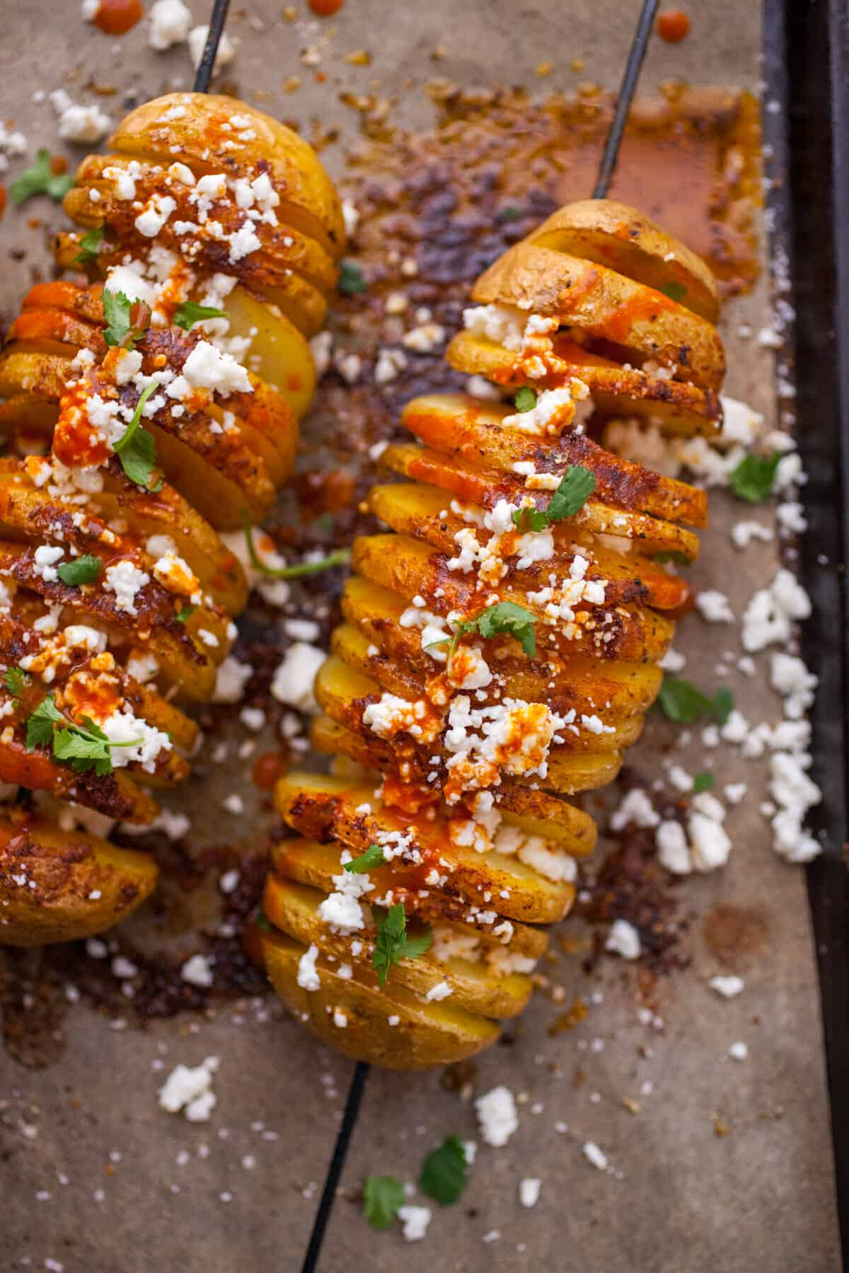 Chili Tornado Potatoes: Perfectly seasoned potatoes cut in a swirl and baked. Topped with a crumble of cheese and cilantro. A great tex-mex or side or party appetizer! | macheesmo.com