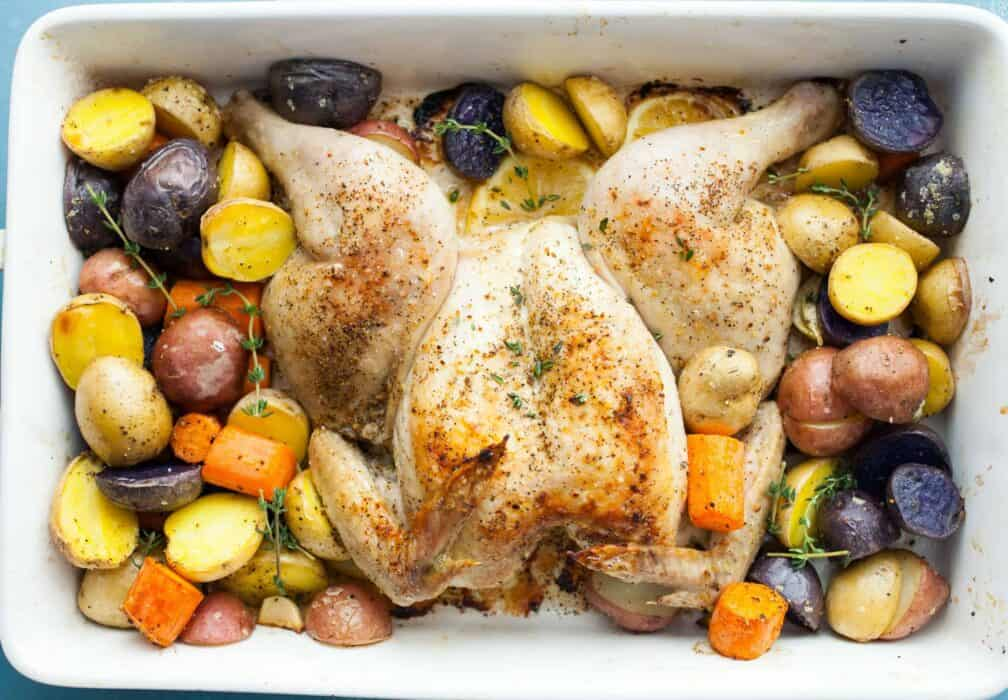 Lemon Pepper Spatchcock Chicken: This is a simple and faster way to make a roast chicken. It has easy-to-find herbs and spices and you bake the whole meal at once! | macheesmo.com