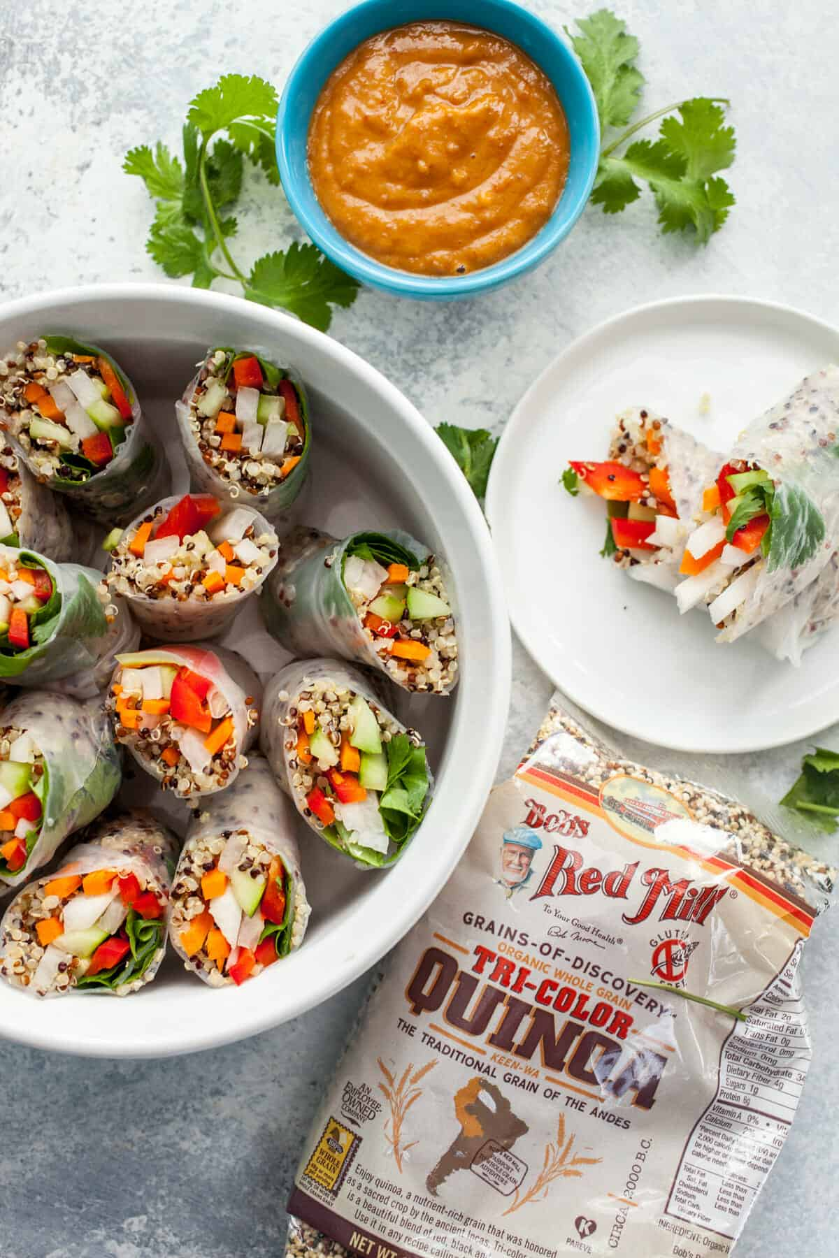 Quinoa Spring Rolls: These bright and crunchy spring rolls are filled with Tri-Color quinoa. I like to serve them with a simple spicy peanut sauce. Great for a healthy party app or you can snag a few of them and make a meal! | macheesmo.com