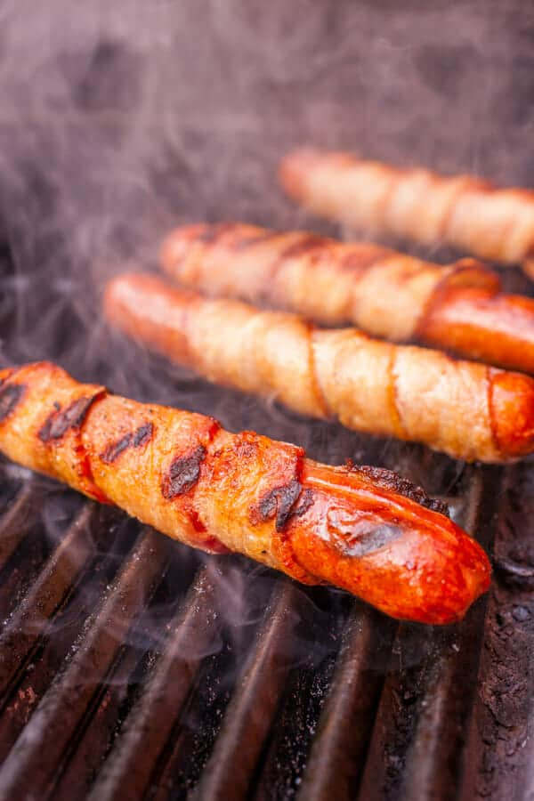 Grilling hot dogs - Sonoran Hot Dogs