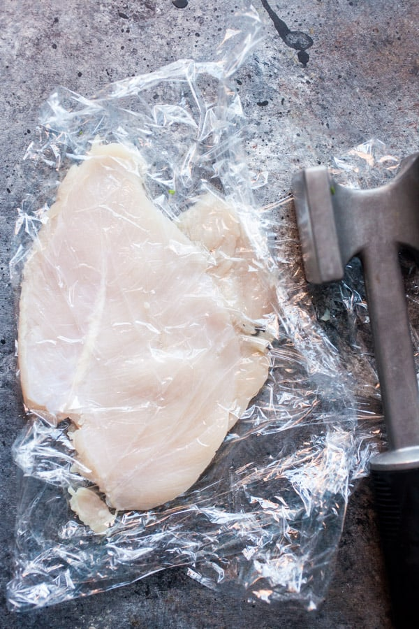 Pounding chicken flat for Chicken Rollatini