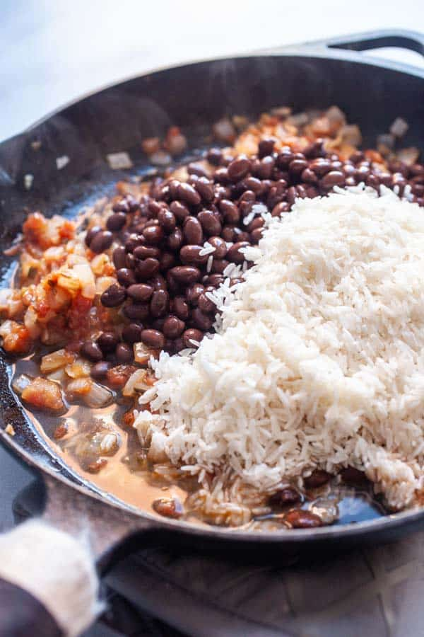 Starting cheesy rice and beans