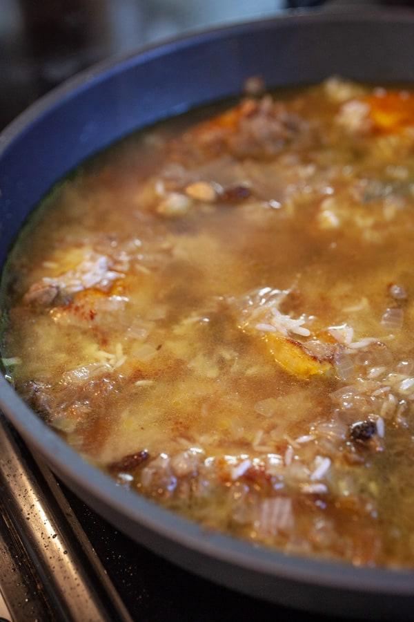 Adding stock - Chicken Biryani