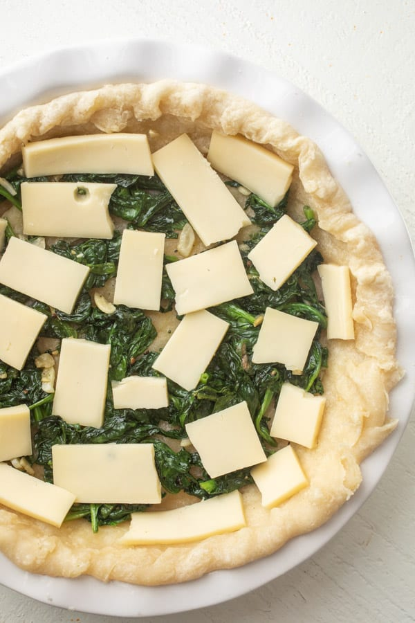 Filling Quiche Florentine with Fontina