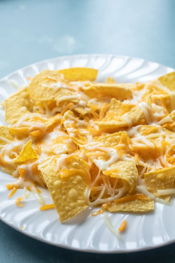 Melted cheese on chips for microwave nachos