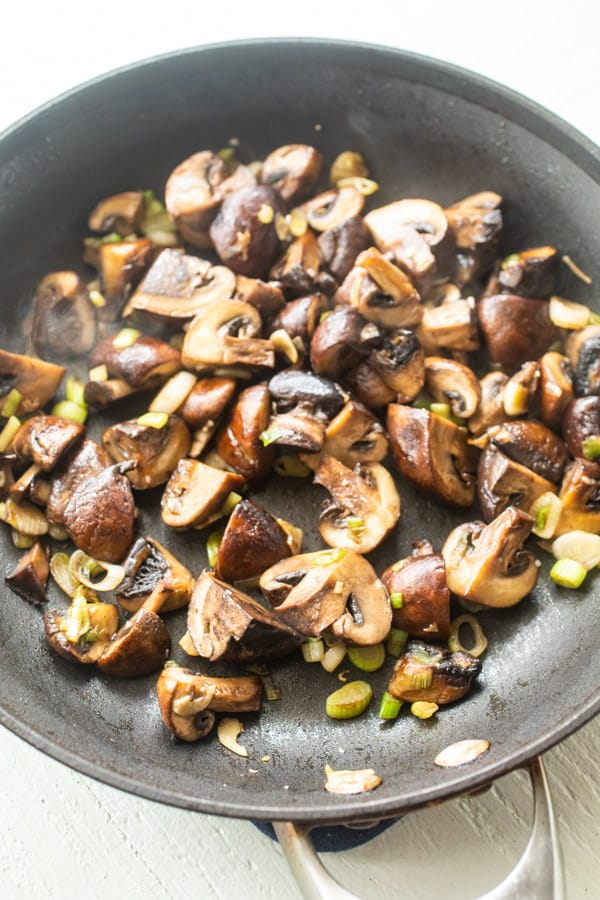 Sauteed mushrooms in a skillet for flatbreads