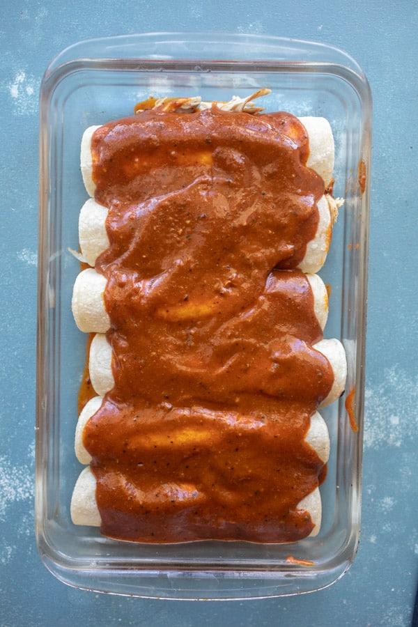 Sauce added to enchiladas