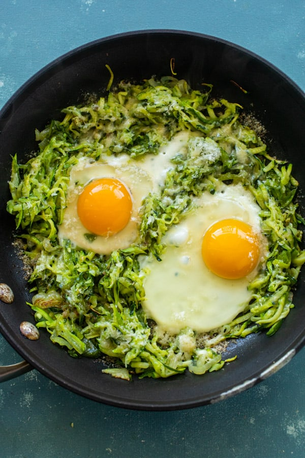 Eggs added to zucchini breakfast skillet.