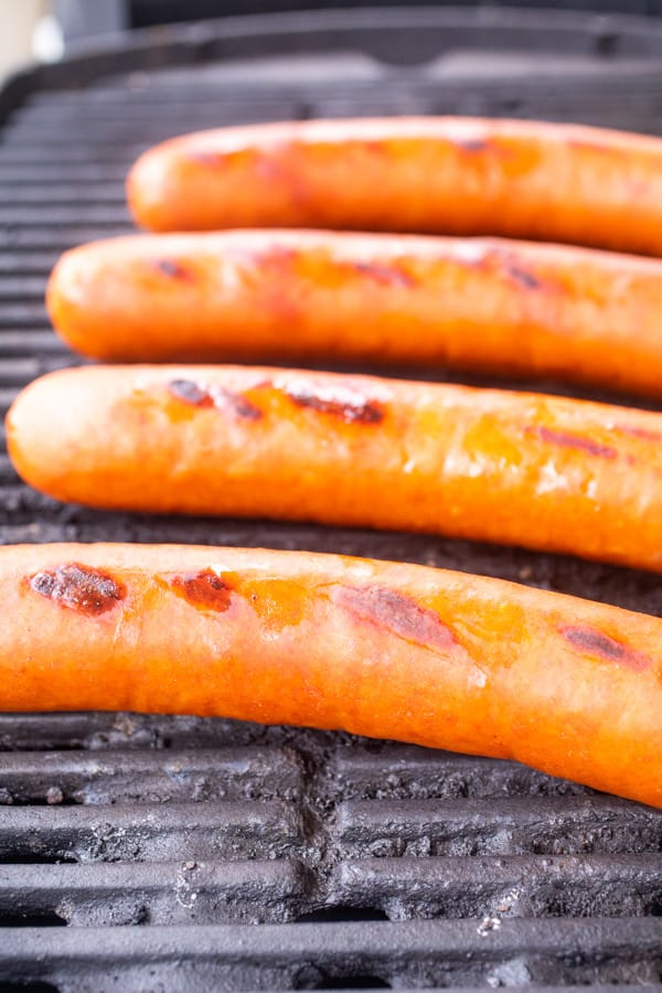 grilling sausages on grill.