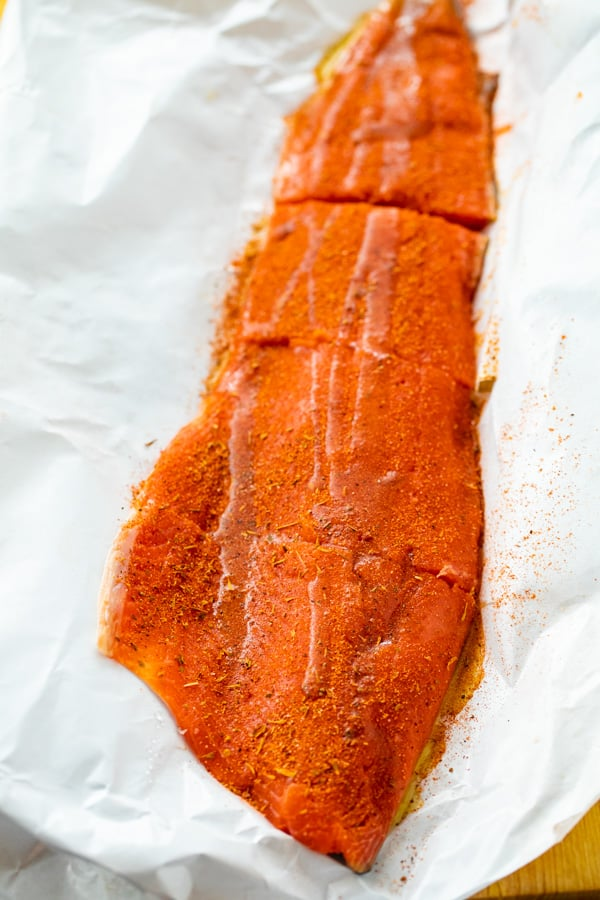 Prepping the Salmon with blackening seasoning.