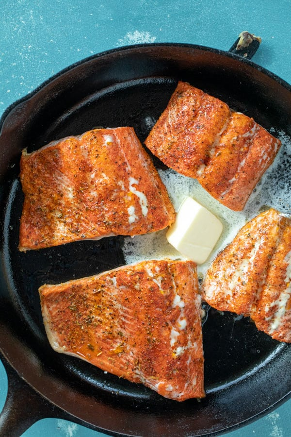 Butter added to blackened salmon