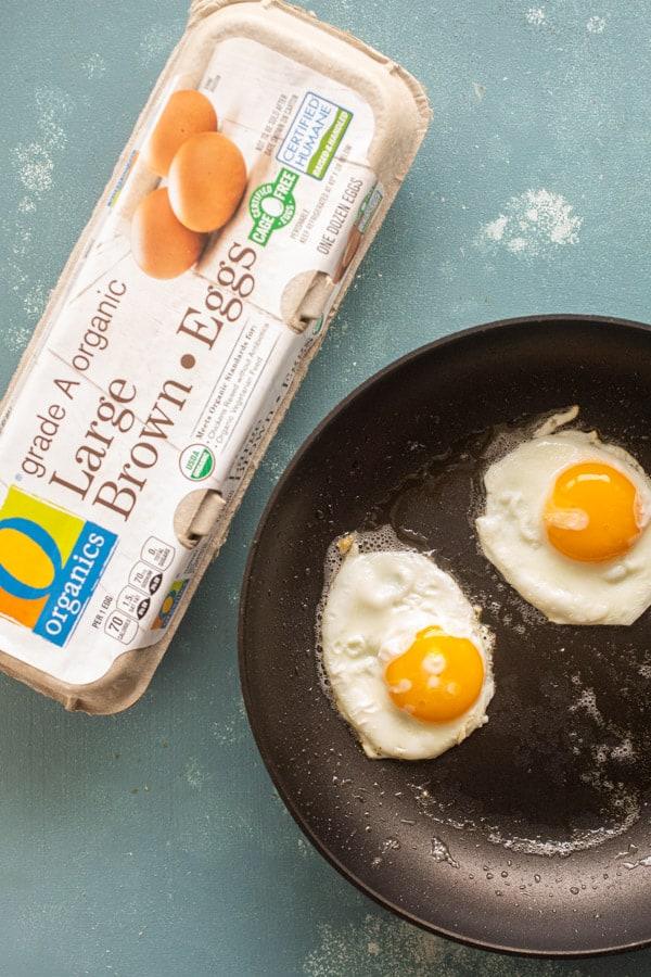 Sunny side up eggs for honey bacon breakfast skillet