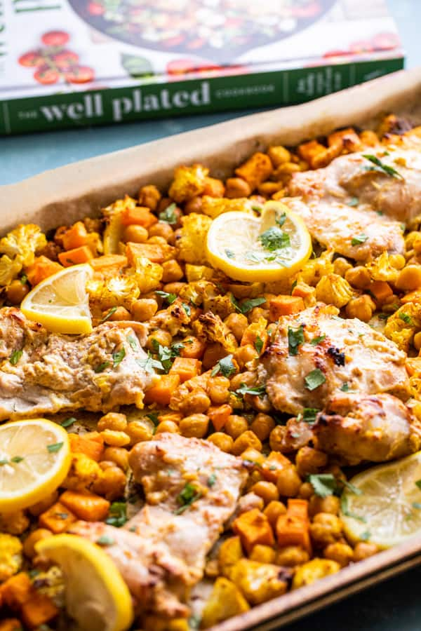 Tandoori Chicken on sheet pan with cookbook.