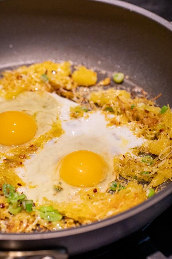 Eggs cracked in for breakfast skillet!