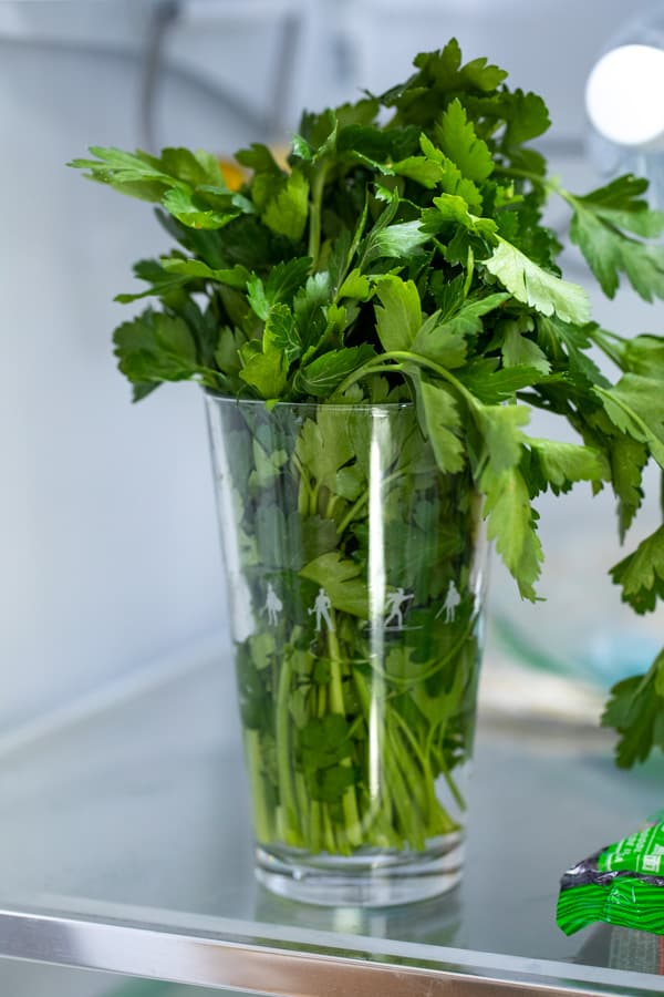Herbs in a pint glass with water