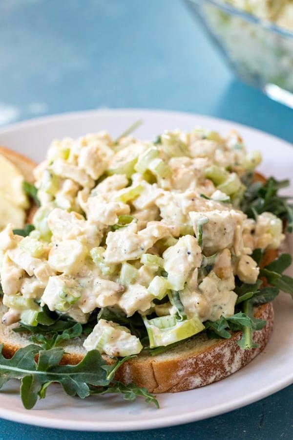 chicken salad on arugula and toast