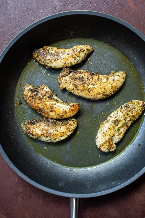 Cooked chicken in a skillet.