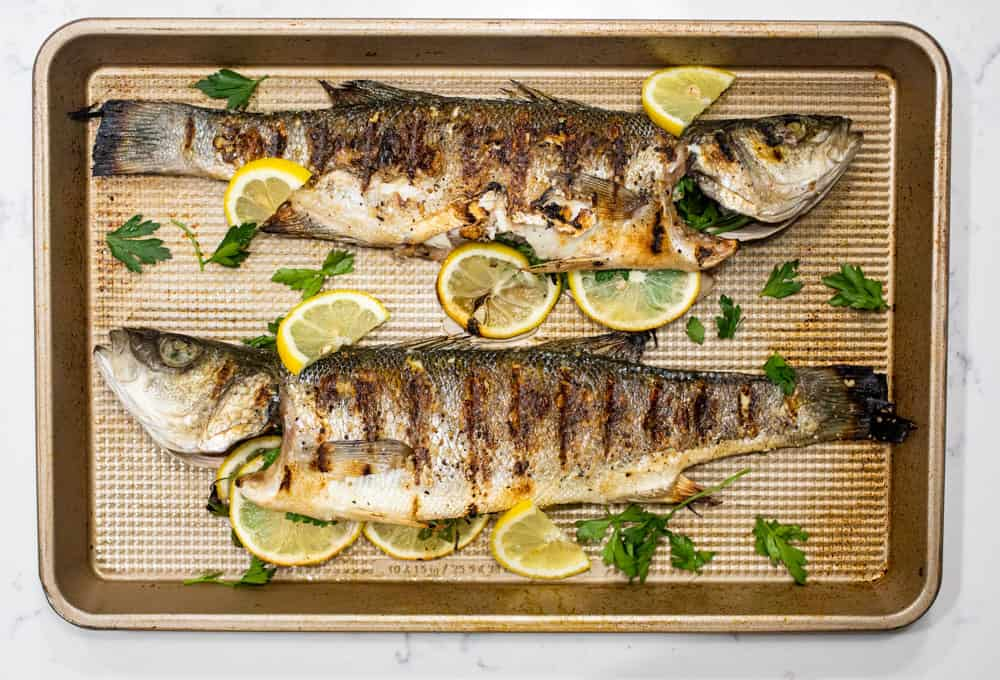 Grilled whole fish on baking sheet