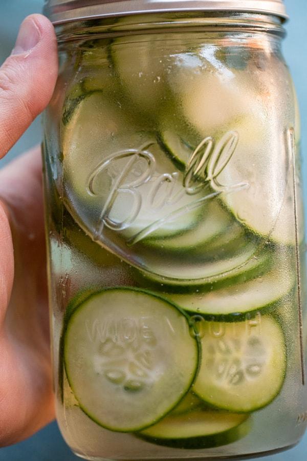 Cucumber with vodka in jar