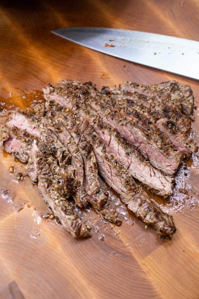 Sliced steak for blue cheese steak salad.