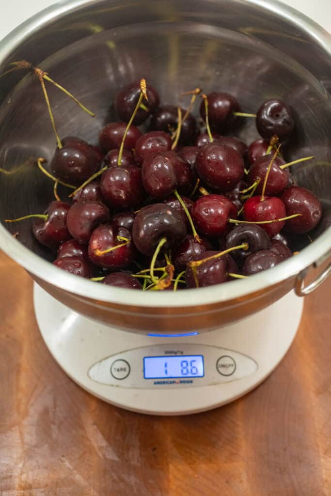Weighing cherries for the compote.