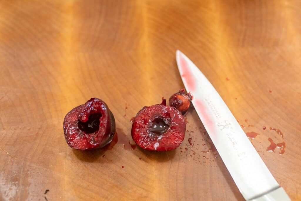 Pitting cherries with a knife.