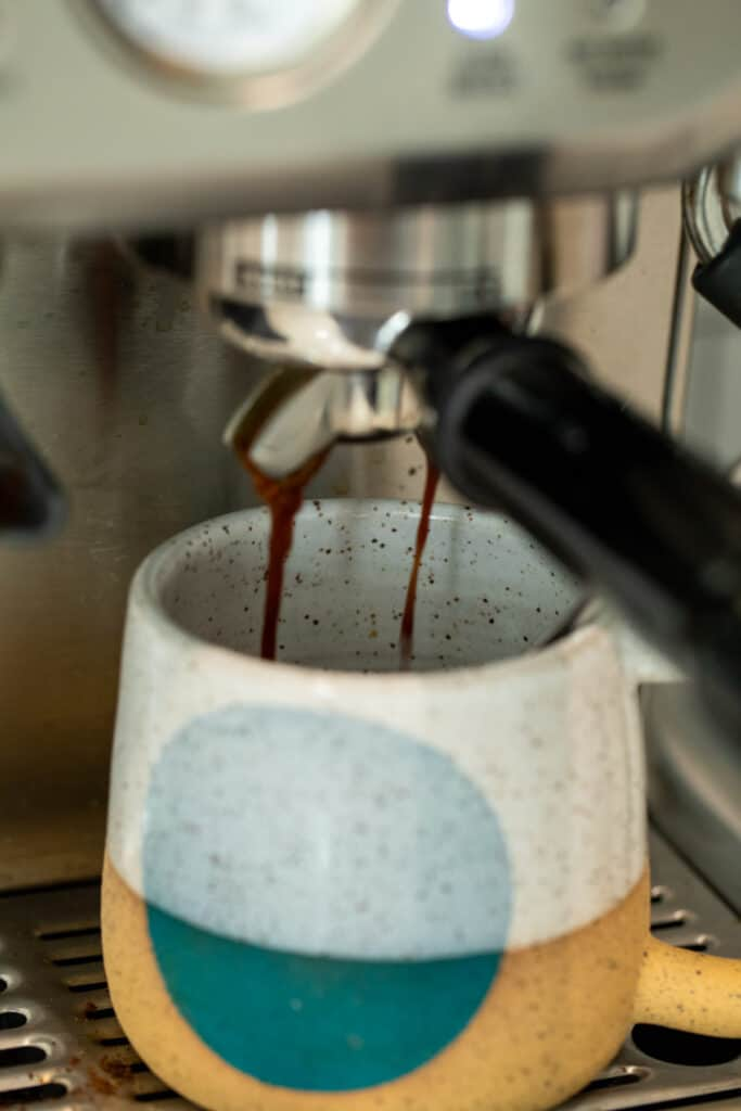 Making espresso for pumpkin spice latte.
